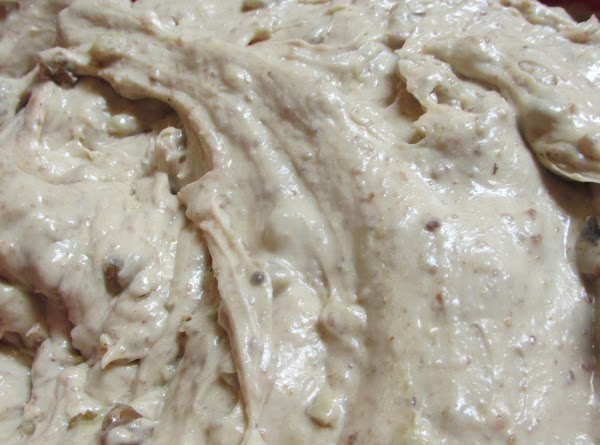 Add the fancy nut filling, beat to blend. Then add the evaporated milk one...