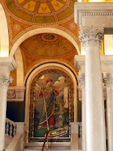 Photo: Elihu Vedder's mosaic at the landing of the stairway into the visitors' gallery of the main reading room. Minerva was the daughter of Jupiter and Metis. She was considered to be the virgin goddess of warriors, poetry, medicine, wisdom, commerce, crafts, and the inventor of music. As Minerva Medica, she was the goddess of medicine and doctors