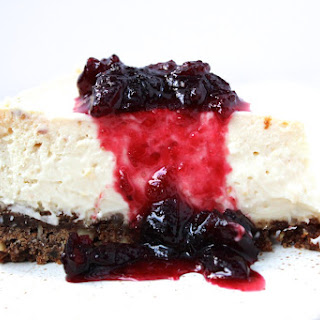 Mascarpone Cheesecake with Gingersnap Crust and Maple Cranberry Compote.
