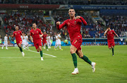 Portugal's Cristiano Ronaldo celebrates scoring their third goal to complete his hat-trick.