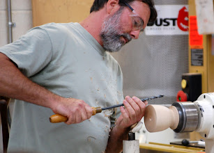 Photo: He measures the depth he wants the bowl to be and grips the drill bit to mark the spot.