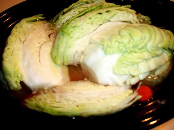 Remove the lid and place cabbage wedges over the top, cover and continue to...