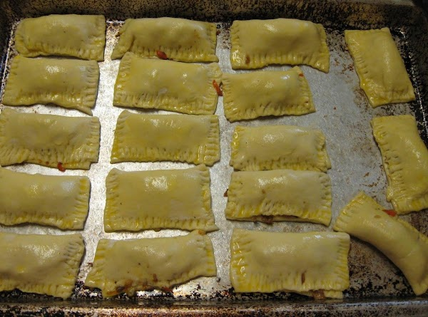 Place the patties on a baking sheet. Brush the tops and edges of the...