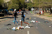 Burnt items, scattered the rubbish bins on campus and broke gates were seen during a TUT students' protest.