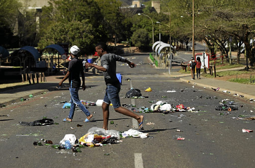 TUT students burnt items, scattered the rubbish bins on campus and broke gates.