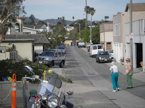 Photo: View down our street from beach (at your back). Our house is just behind silver SUV on left of picture