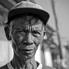 Fisherman's Day Dream by Hengki Lee - People Portraits of Men
