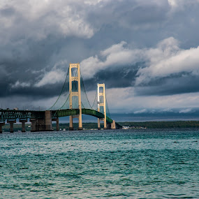 The Mighty Mac by Darrin Ralph - Buildings & Architecture Bridges & Suspended Structures ( lake michigan, sky, blue, bridge, clouds, water )