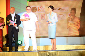 Photo: Thai Prime Minister Yingluck Shinawatra receiving the first bottle in Thailand of FASHION – Spring Water from austria, from FashionTV president, Michel Adam. August 10, 2012 at an event in honor of Queen Sirikit's 80th birthday in Bangkok.