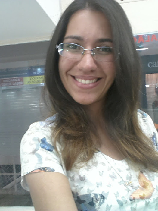selfie da cliente mostrando seu cabelo escovado