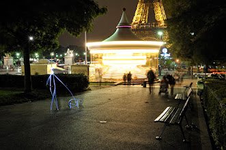 Photo: A man and a dog passing by a carrousel in Paris. Carrousel II - Light painting by Christopher Hibbert, french photographer and light painter. Further information: http://www.christopher-hibbert.com