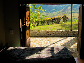 Photo: This is another of the guest rooms at the Finca with another wall that opens up to the garden outside.