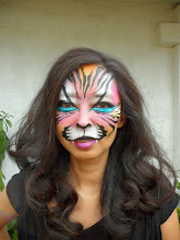 Photo: Tiger face paint by Heidi, La Verne, CaBook Heidi by calling 888-750-7024