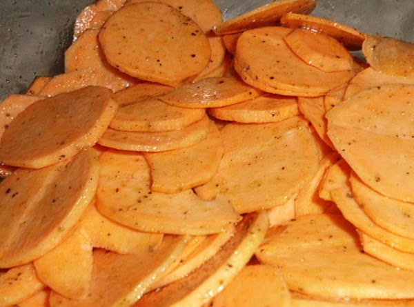 Peel potatoes and slice into thin rounds.  Place in a bowl, drizzle with...