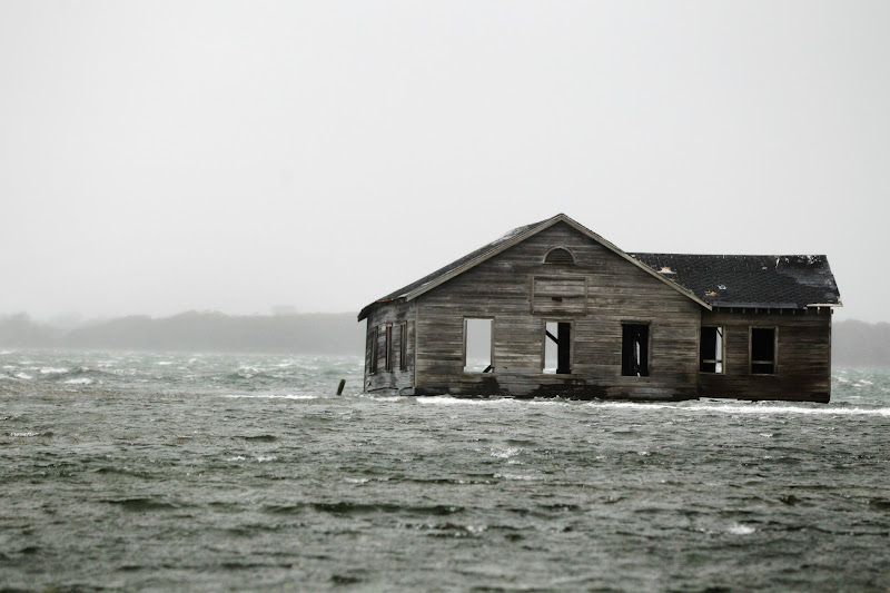 Photo: An abandoned home is inundated with water at Shinnecock Bay in Southampton, New York.