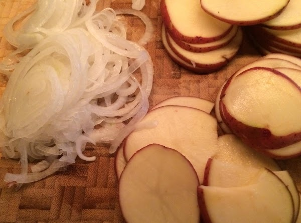 Preheat oven 350 degrees. Slice the potato and onion @ 1/4 inch thick