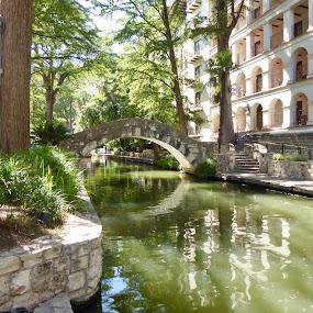 San Antonio Riverwalk  by Kerry Demandante - City,  Street & Park  City Parks ( ripples, promenade, reflections, river, bridge, arch, texas, water, trees, staircase, steps, architecture )