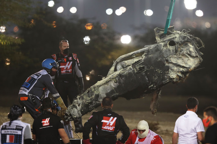 Track marshals clear the debris after the crash of Romain Grosjean of France and Haas F1 during the F1 Grand Prix of Bahrain at Bahrain International Circuit on November 29 2020.