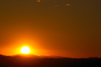 Photo: The sun sets in the desert.