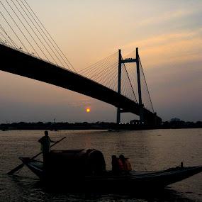 Sunset at princep ghat by Hrijul Dey - Buildings & Architecture Bridges & Suspended Structures ( sunset, river, skyline, bridge, sun, boat,  )