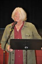 Photo: Stephen Roxborough performs one of his poems.