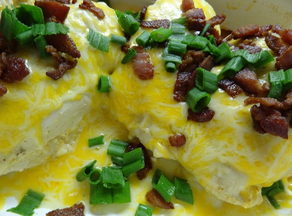 Cook up bacon 5 minutes before serving. Cover chicken with remaining cheese, green onions,...
