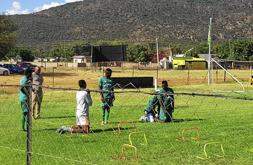 Some Baroka players training separately from the rest of the team at Seleteng, GaMphahlele, including captain Olaleng Shaku, far left. Watching them is CEO Morgan Mammila. /Tiyani Mabasa