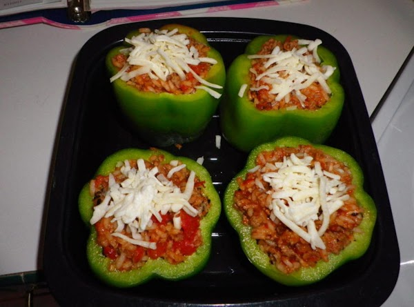 Place the stuffed peppers in a roasting pan and put 1/8 cup water and...