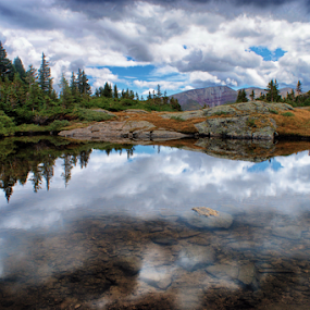 Mountain Reflections by Brian Kerls - Landscapes Waterscapes ( stormy, mountain, tarn, rock, solitude, travel, storm, hiking, alpine, sky, tree, nature, camping, mohawk lake, trail, light, trekking, tourism, forest, lake, serene, outdoors, trees, western, rockies, ten mile range, natural, outside, calm, reflection, peak, rocky, landscape, usa, mirror, tranquil, mountains, conservation, pool, continental divide, cloudy, summit county, pond, rocks, rugged, clouds, water, rocky mountains, environmental, backpacking, summit, evergreen, peaks, hike )