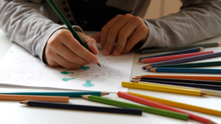 close up of boy coloring