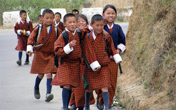 Photo: Everybody in Bhutan is attired in their national dress, even school children.