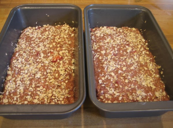 Pour into the prepared loaf pans.  Sprinkle each with 1 Tbsp of oats.
