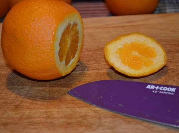 Slice off the ends of the oranges.
