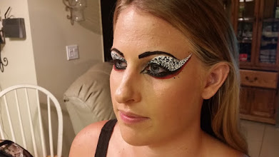 Photo: Aduilt face painting by Tess. Call to book her today at 888-750-7024.