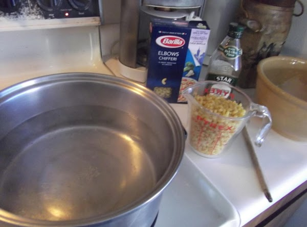 Bring about 4 quarts of water to a full boil, adding a little olive...