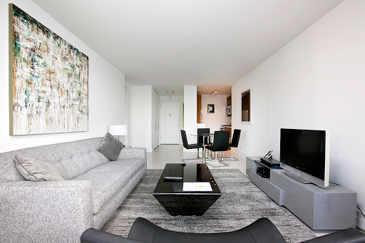 SWEEPING RIVER VIEWS 34TH FLOOR WITH LUXURY AT YOUR DOOR STEP-EAST 52ND