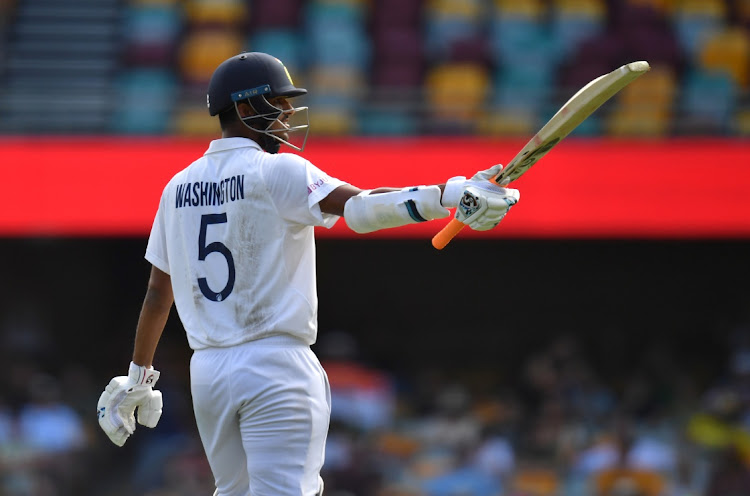 Washington Sundar of India celebrates his half century during day three of the Test match between Australia and India, at the Gabba in Brisbane, Australia, January 17 2021. Picture: AAP IMAGES/DARREN ENGLAND/REUTERS