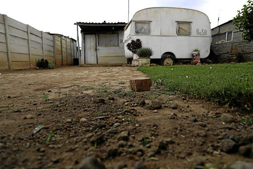 An entrance to the yard where a man was allegedly stoned to death by a couple on Sunday morning. /Sandile Ndlovu