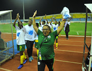 Banyana Banyana head coach Desiree Ellis leads a celebration with her players after beating Mali 2-0 to advance to the final of the Caf Women's Africa Cup of Nations against Nigeria. South Africa also qualified for the 2019 Fifa Women's World Cup.