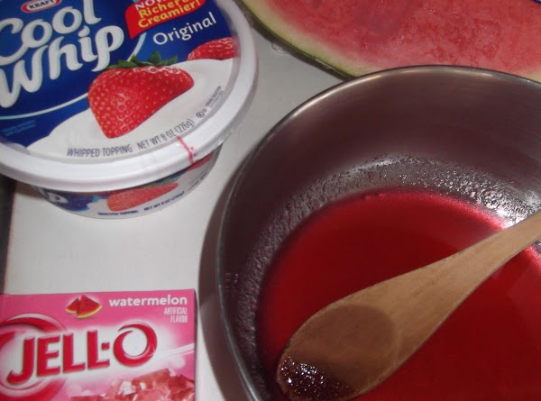 Dissolve jello in boiling water in large bowl.  Cool to room temperature.