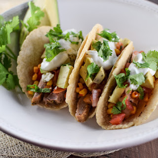 Pork Tacos With Avocado Corn Salsa.