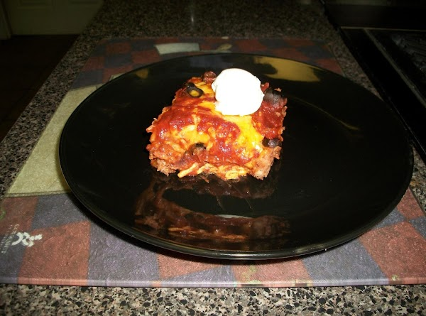 POUR THE REMAINING ENCHILADA SAUCE OVER THE TOP AND ADD YOUR SLICED OLIVES. BAKE...