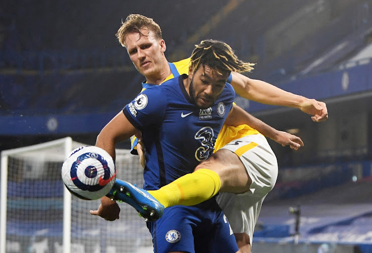 Chelsea's Reece James in action with Brighton & Hove Albion's Dan Burn