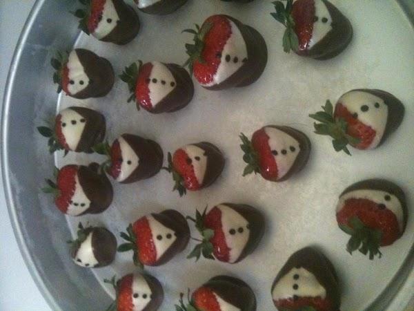 "Make ""tuxedo"" strawberries. Set on cake accordingly."