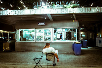 Photo: Last Call  Found this gentleman sitting alone in an almost closed down Madison Square Park around midnight on a Sunday night. Perhaps he didn't realize Shake Shack was closed or maybe he was prepared to wait until the morning to be the first in line! This was shot with a brand spanking new Fujifilm X100. Great Camera!