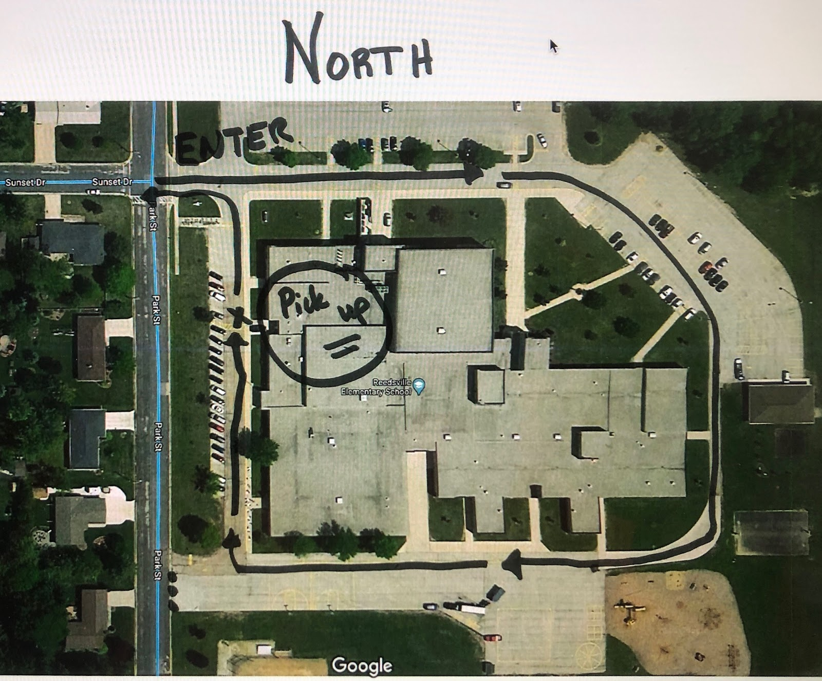 aerial view of Elementary Middle School with driving directions for pick up