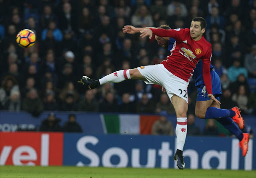 Henrikh Mkhitaryan of Manchester United in action with Danny Drinkwater of Leicester City during the Premier League match between Leicester City and Manchester United at The King Power Stadium on February 5, 2017 in Leicester, England. (Photo by Matthew Peters/Man Utd via Getty Images)