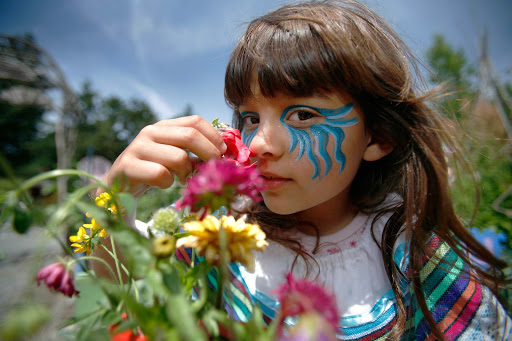 A girl at Glendale Gardens in Victoria. You'll find the Organic Islands Festival there each July.