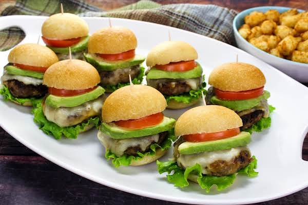 A Tray Of Turkey Burgers With Green Apple.