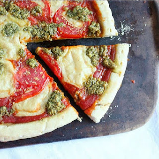 Margherita Pizza With Fresh Basil Pesto and Mozzarella [Vegan].
